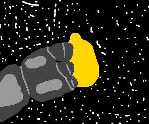 Metal hand grabbing a lemon in space