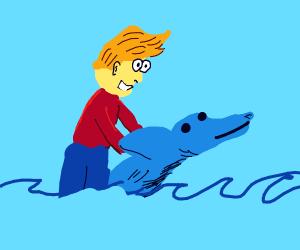 Jazza neets a black and blue dolphin
