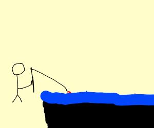Guy fishing in a pool