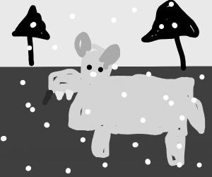 Wolf walking through a snowy forest.