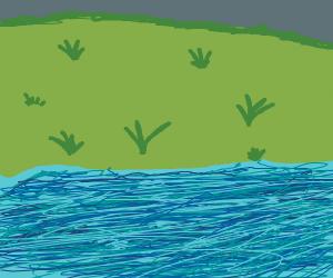 grass hill behind lake