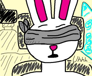 Long-eared bunny tries bird box challenge