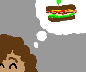 Girl daydreams about sandwich
