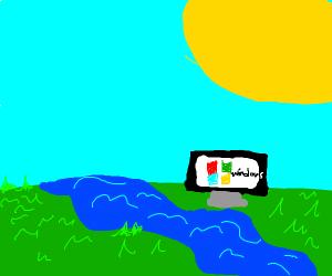 A PC Monitor At a River
