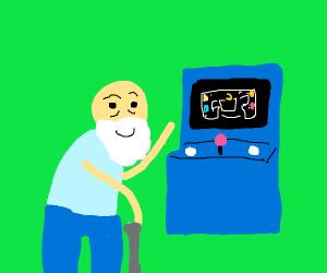 old man playing arcade game