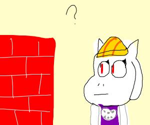 Hardhat goat constructing a brick building.