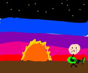 Sad boy play guitar at sunset