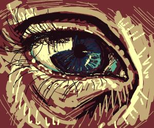 Closeup of a tearing blue eye