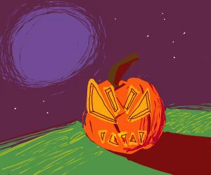 Jack O' Lantern under the moon on grass