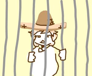 sad man wearing sombrero got in jail
