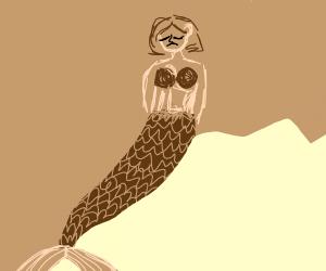 brown mermaid looks sad