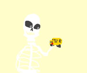 Skeleton holding toy bus