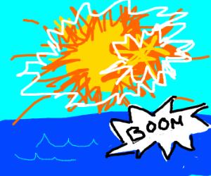 Sun explodes over ocean