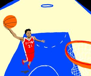 A guy playing basketball