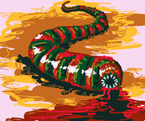 Orange and Green worm living in the dirt