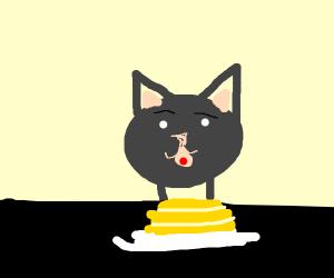 CAT EATING A PANCAKE