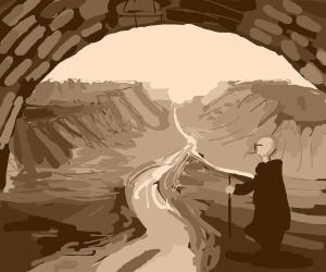 Man under bridge gazes at canyon + river