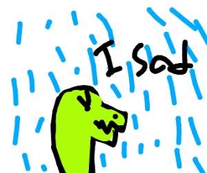 Sad dinosaur in the rain