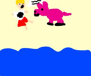 Lifeguard socialises with a pig