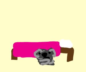 dog stuck under bed
