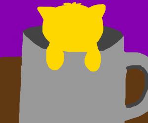 a kitten in a mug