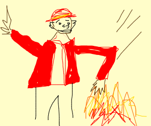 Fireman smacks fire with hand.