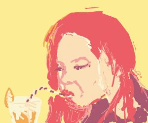 Red haired woman drinking orange juice