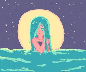 Girl rising from water at night