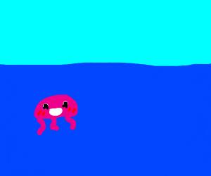 Cute pink jellyfish in the ocean