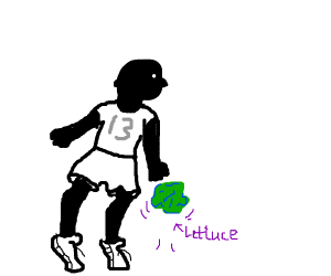 Black guy dribbling lettuce