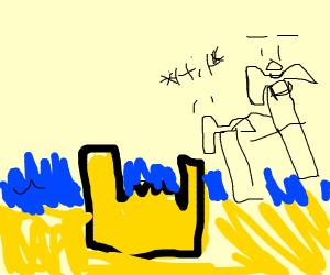 Hammer uses hammer to hit sand castle