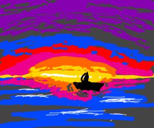 Lone sailboat at sea during sunset