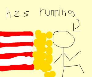 A man running away from falling popcorn