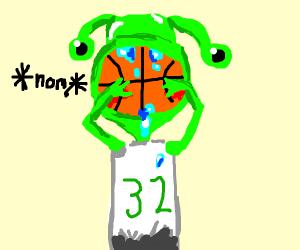 Alien eating a basketball