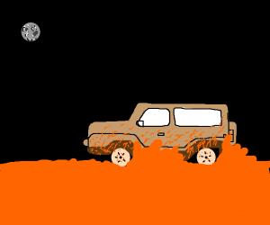 Car drives through mud