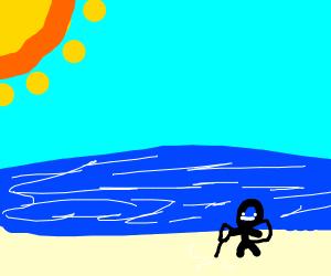 Vacuuming the beach