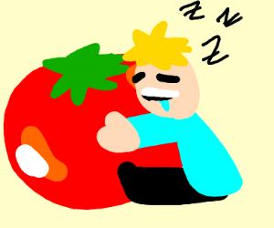 Sleepily cuddling a giant tomato