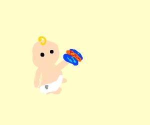 Baby holds blue hotdog bun