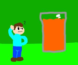 Man staring at huge orange juice glass