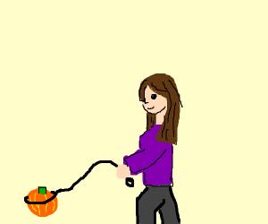 Woman walks a pumpkin