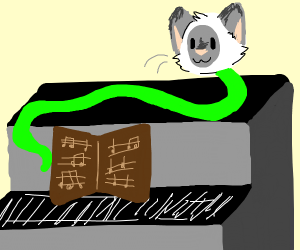 Green snake with cat head on a piano