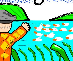 Man waving at sea of ducks