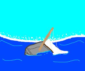 a boat dragging sails
