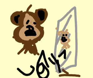 Depressed monkey man looking through mirror.