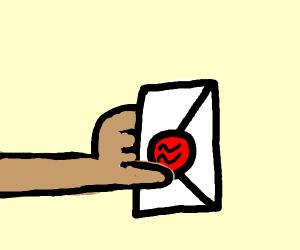 A hand holding a wax sealed envolope