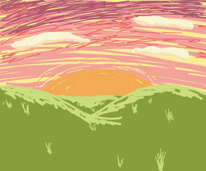 Sunset over the grassy hills