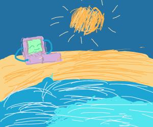 Gameboy advance SP on a beach