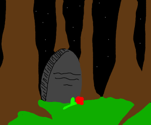 a single gravestone in the forest