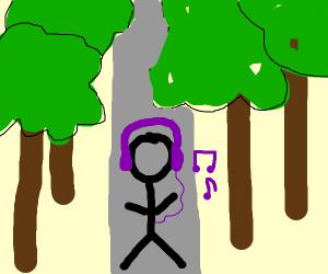 Wearing headphones in the woods