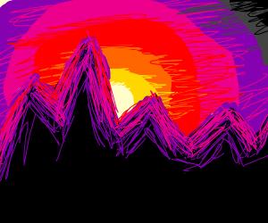 Purple mountains under a sunset